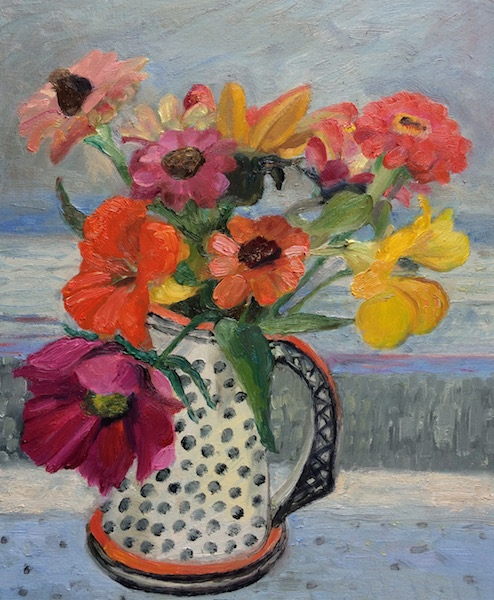 Zinnias in a spotted jug