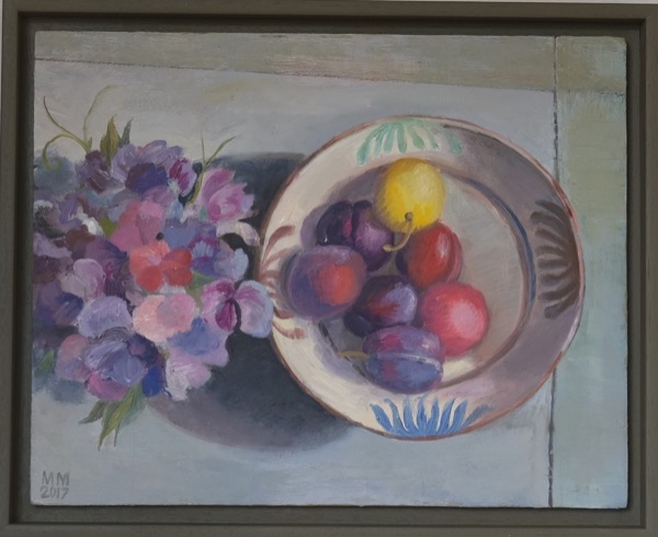 Plums on a painted table